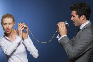 Businessman Reprimanding Woman Through Tin Can Phone